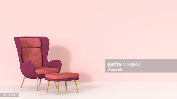Retro style arm chair and stool against pink wall