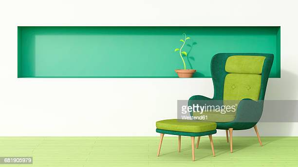 Retro style arm chair and stool with plant growing in green shelf