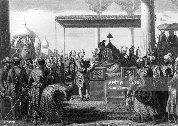 Robert Clive , British governor of India receives from Shah Alam, the Mughal Emperor of India, a decree conferring upon the East India Company the...