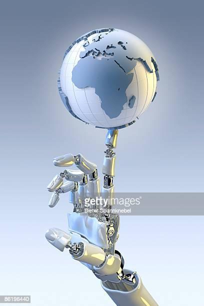 robot hand balances a globe showing europe africa - 機械アーム点のイラスト素材/クリップアート素材/マンガ素材/アイコン素材