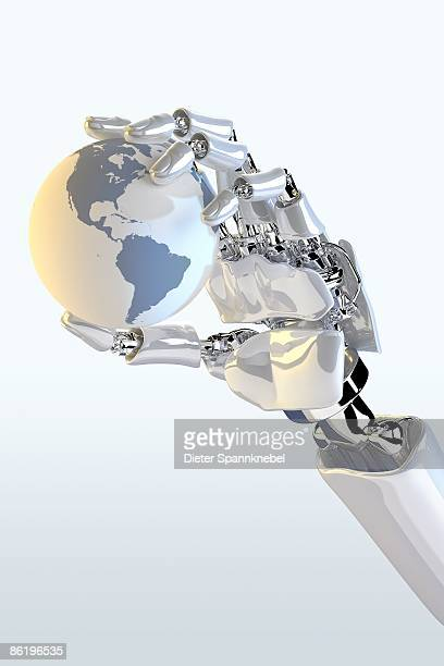Robot hand holds a globe showing America