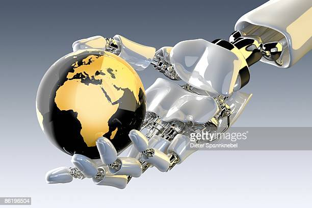 Robot hand holds a globe showing Europe and Africa