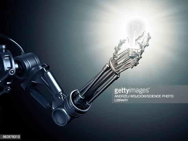 Robotic hand holding a lightbulb