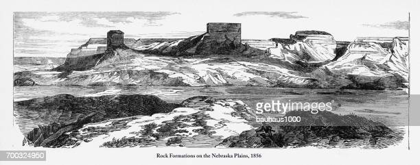 rock formations on the nebraska plains victorian engraving, 1856 - midwest usa stock illustrations