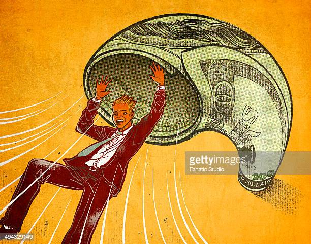 Rolled up paper currency throwing businessman over colored background depicting inflation