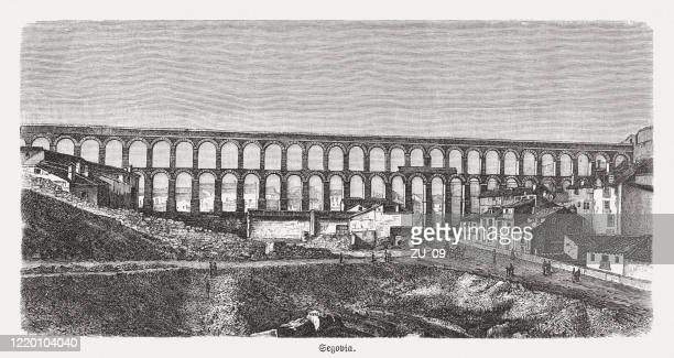 roman aqueduct of segovia, spain, wood engraving, published in 1893 - segovia stock illustrations