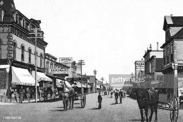 rosser avenue in brandon, manitoba, canada - 19th century - powerofforever stock illustrations