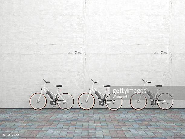 row of three parked electric bicycles in front of concrete wall, 3d rendering - outdoors stock illustrations