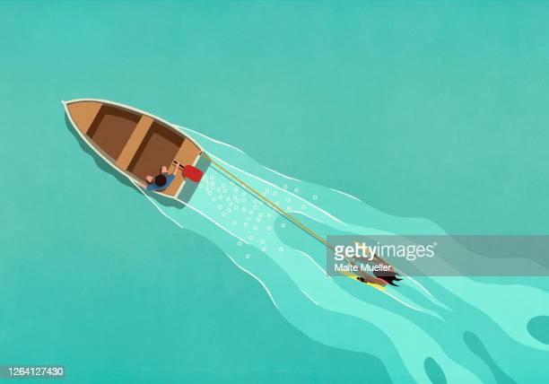 rowboat pulling water skier - transportation stock illustrations