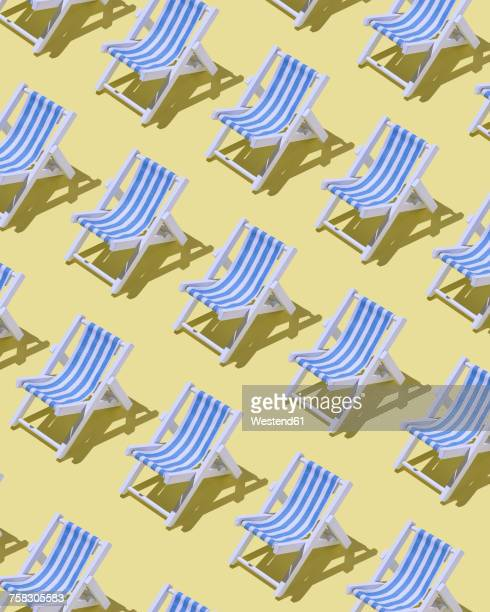 ilustraciones, imágenes clip art, dibujos animados e iconos de stock de rows of beach chairs on yellow ground, 3d rendering - vacaciones de sol y playa