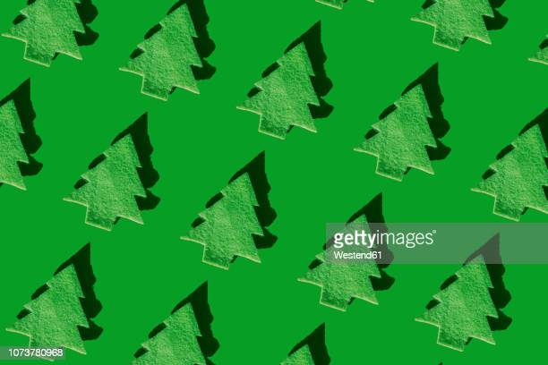rows of green christmas trees on green ground, 3d rendering - close up stock illustrations
