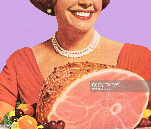 1950's housewife holding a ham dinner, smiling