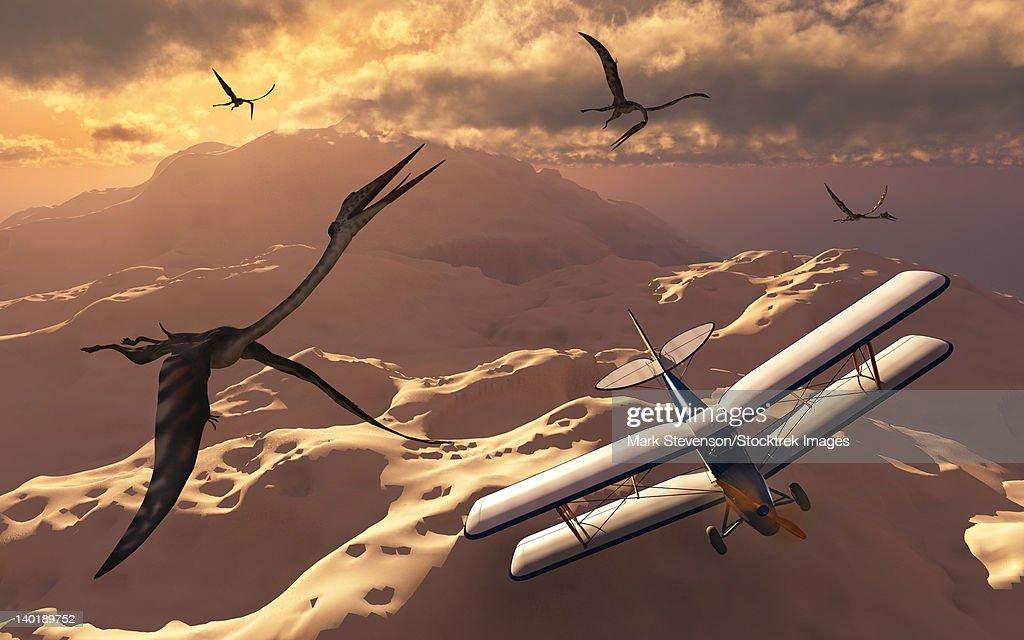 A 1930's Tiger Moth biplane passes through a flock of prehistoric Quetzalcoatlus pterosaurs. : stock illustration