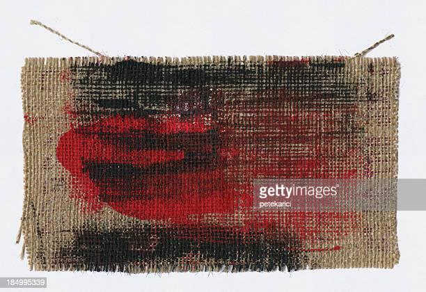 Saco têxteis e de tinta vermelha