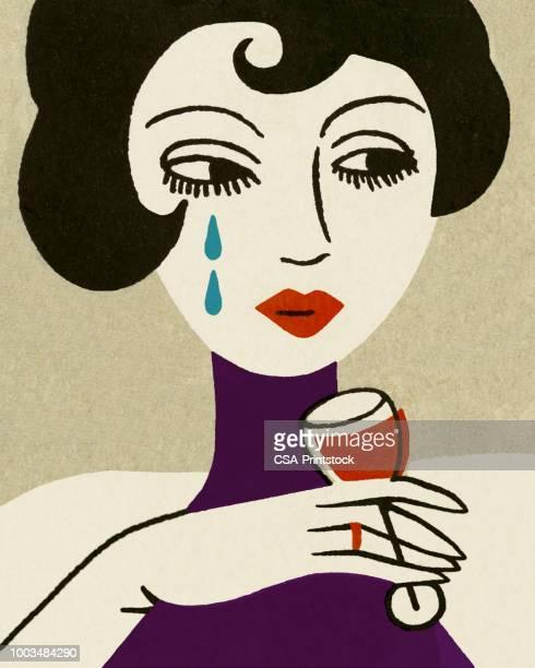 sad woman drinking wine - teardrop stock illustrations