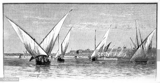 sailboats on the nile egypt in 1895 - nile river stock illustrations, clip art, cartoons, & icons