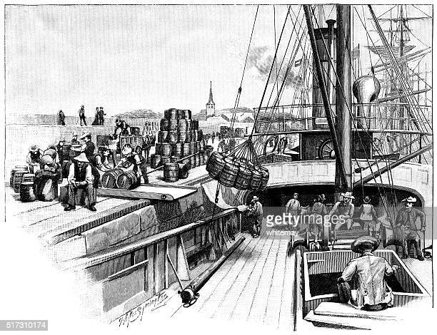 Sailing ship loading or unloading cargo in port
