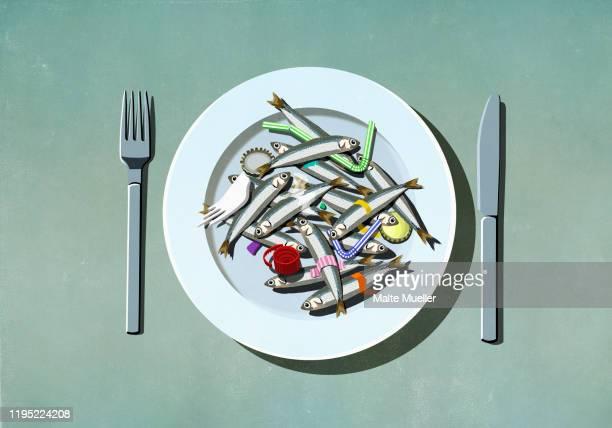 sardines, plastic straws and pollution on plate - plastic stock illustrations