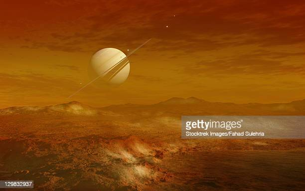 Saturn above the thick atmosphere of its moon Titan.