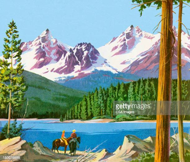 Scenic Mountains And People on Horses