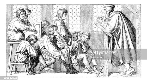 School teacher teaching pupils in classroom Germany medieval