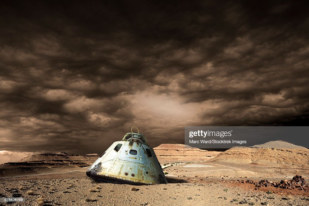 A scorched space capsule lies abandoned on a barren world.  : stock illustration