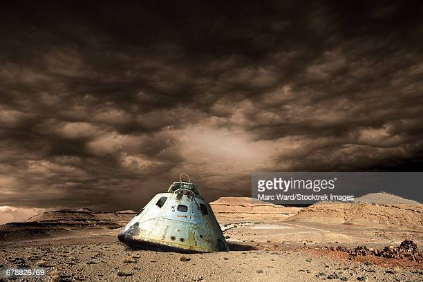 A scorched space capsule lies abandoned on a barren world.