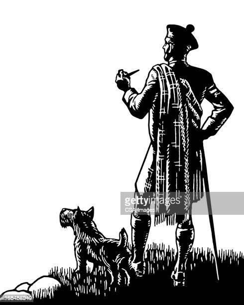 Homme et son chien écossais