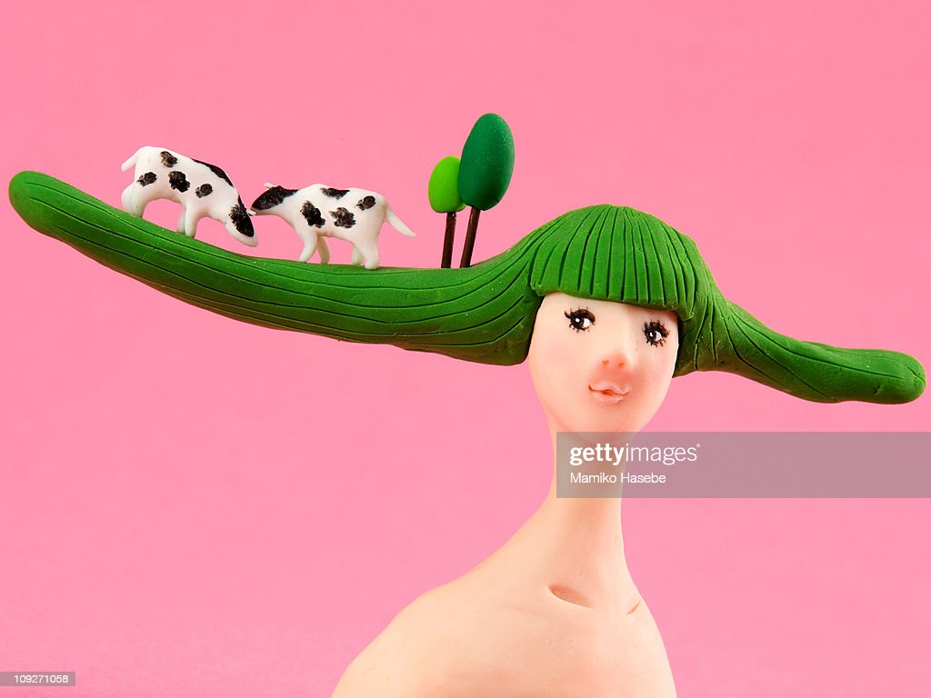 A sculpture of a woman with a rural scene on her hair : stock illustration