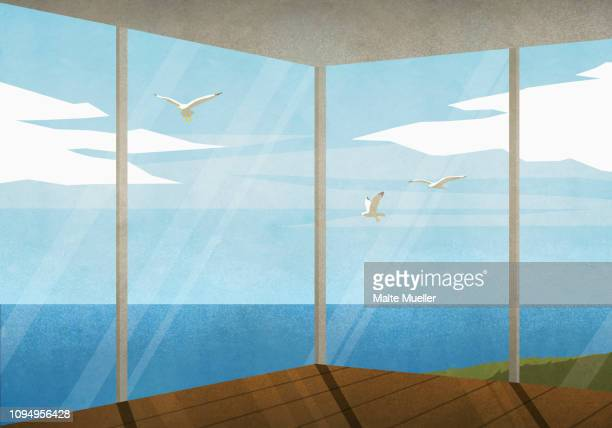seagulls flying outside beach house with ocean view - silence stock illustrations