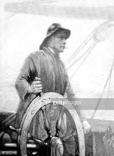 Seaman at the steering wheel on the sea