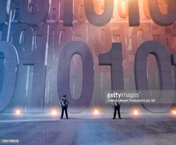 security officers guarding binary code - 45 49 years stock illustrations, clip art, cartoons, & icons