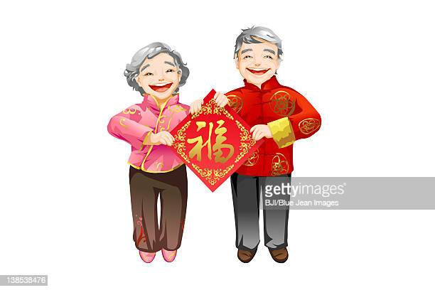 Senior couple holding Chinese New Year blessing character