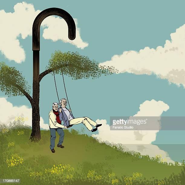 senior couple swinging - 年配のカップル点のイラスト素材/クリップアート素材/マンガ素材/アイコン素材
