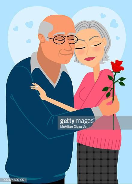 senior man and woman embracing, eyes closed, man holding rose - 年配のカップル点のイラスト素材/クリップアート素材/マンガ素材/アイコン素材