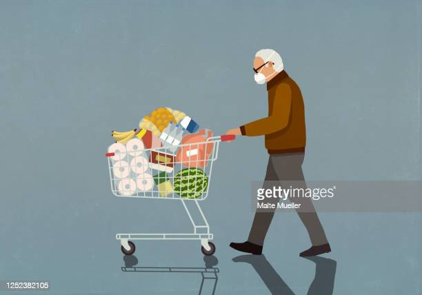 senior man with protective face mask pushing groceries in shopping cart - transportation stock illustrations