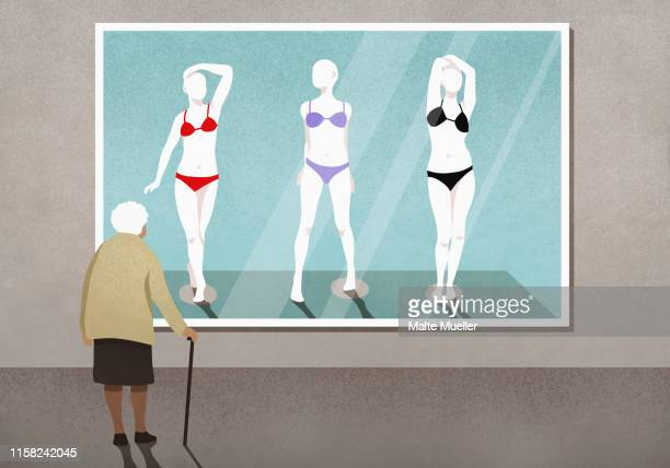 senior woman looking at bikinis on mannequins photograph in art gallery - female likeness stock illustrations