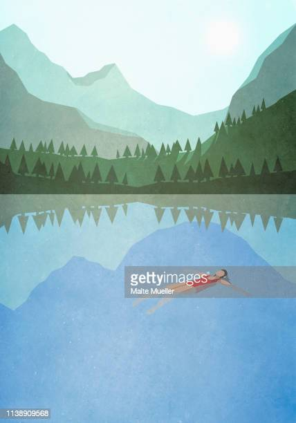 serene woman floating on back in tranquil mountain lake - entspannung stock-grafiken, -clipart, -cartoons und -symbole