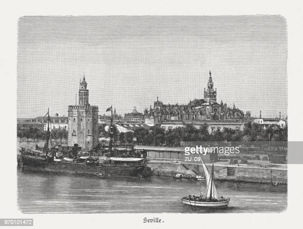 seville, spain, guadalquivir river and golden tower, woodcut, published 1897 - seville stock illustrations, clip art, cartoons, & icons