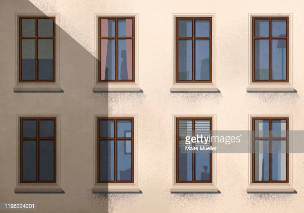 shadow over apartment building with windows - unrecognisable person stock illustrations