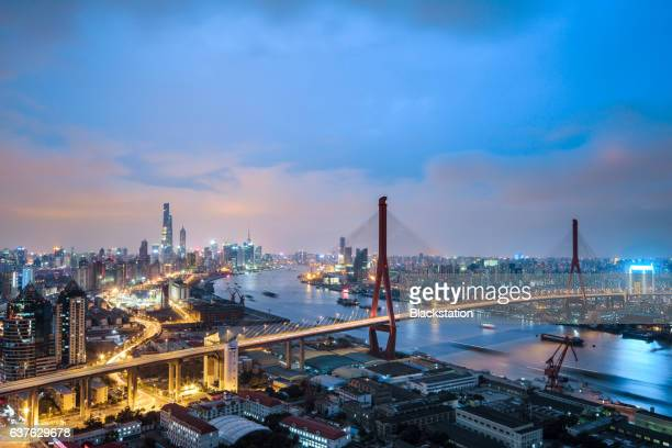 shanghai is divided into two parts by the huangpu river - tall high stock illustrations
