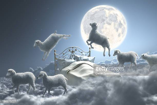 sheep jumping over bed in a cloudy moon scene - sheep stock illustrations, clip art, cartoons, & icons