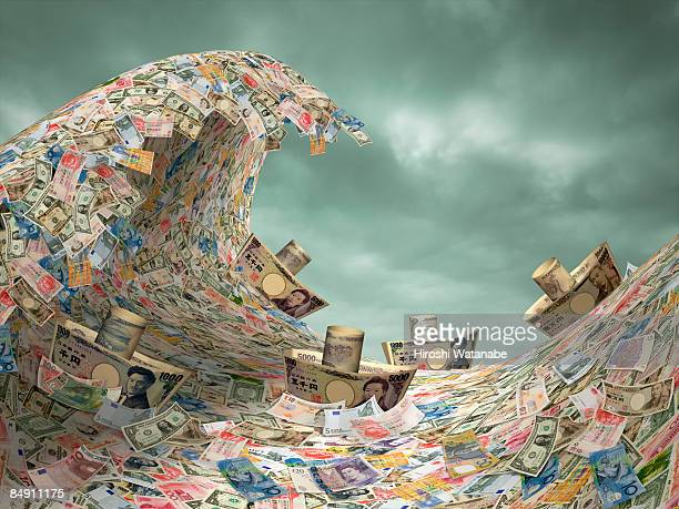 Ship of paper currency get over big wave