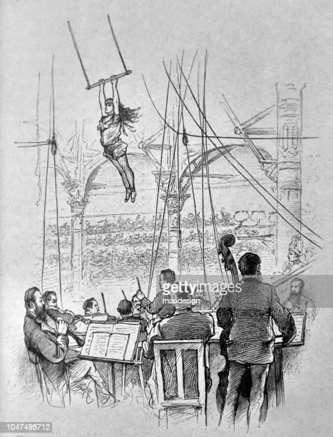 Montrer sur un trapèze dans un cirque. L'orchestre accompagne cet événement - 1888