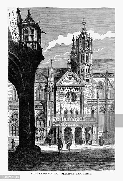 side entrance, freiburg minster cathedral in breisgau, germany circa 1887 - freiburg im breisgau stock-grafiken, -clipart, -cartoons und -symbole