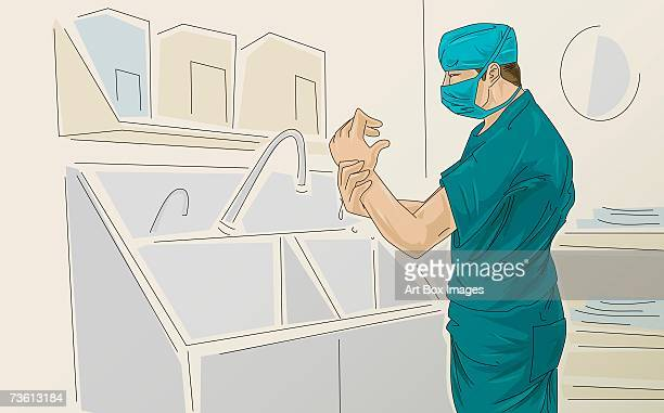 Side profile of a male surgeon washing hands under a faucet