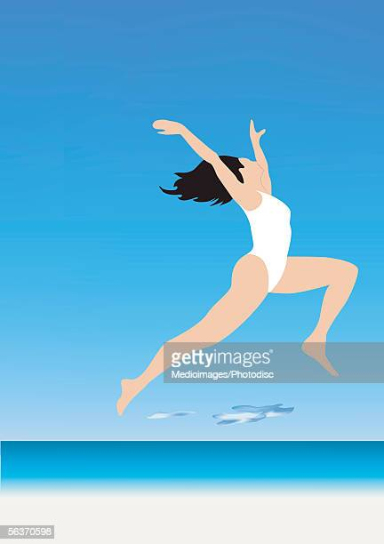 Side profile of a woman jumping with her arm raised