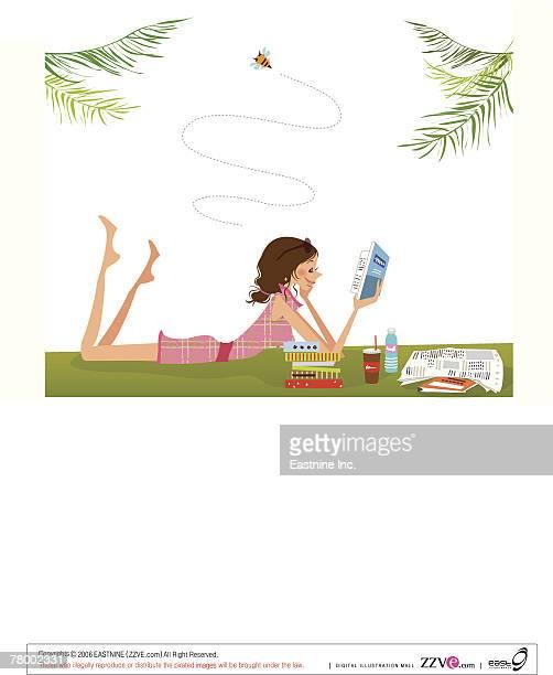 ilustraciones, imágenes clip art, dibujos animados e iconos de stock de side profile of a woman lying on the grass and reading a book - libros volando