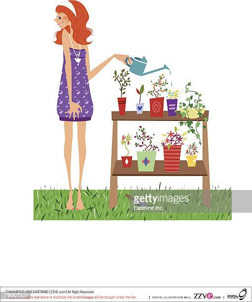 Side profile of a woman watering potted plants