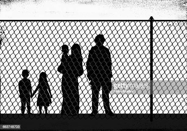 silhouette family standing in front of fence - family stock illustrations
